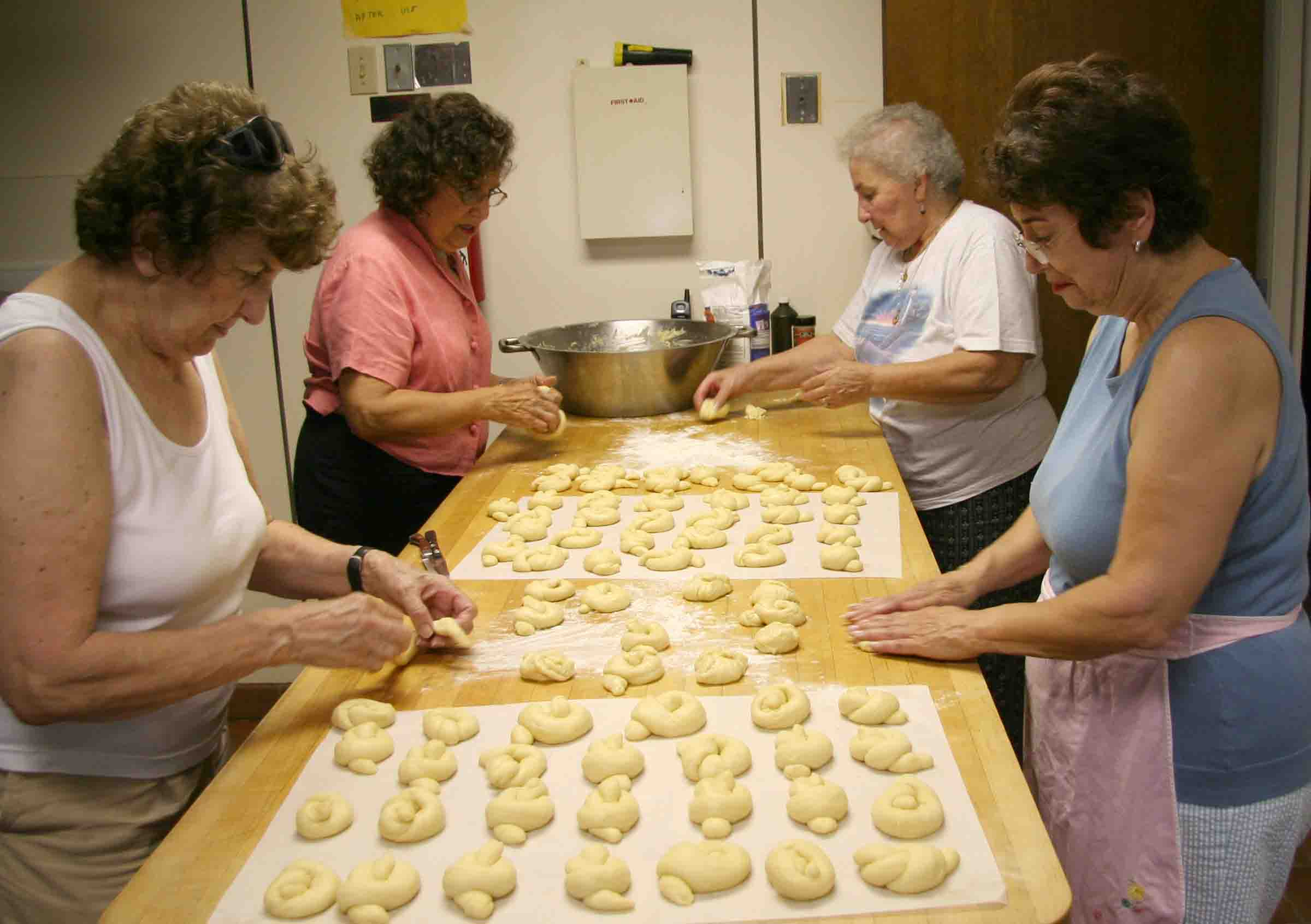 Local women prepare forty dozen choereg, a traditional Armenian sweet roll, for the Armenian Fest held in Springfield, MA.
